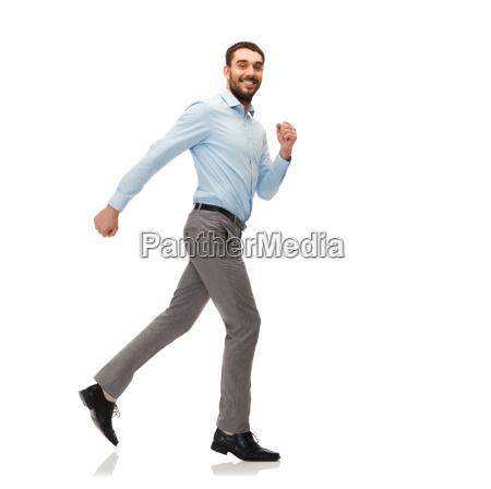 smiling young man running away
