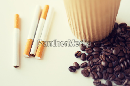 close up of cigarettes coffee cup