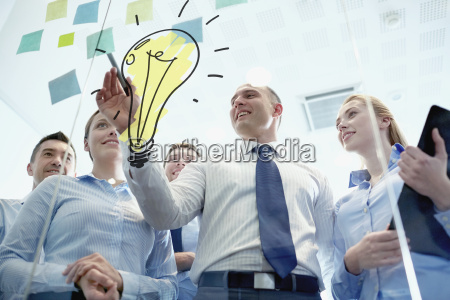 smiling business people with marker and