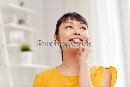 happy asian young dreaming woman face