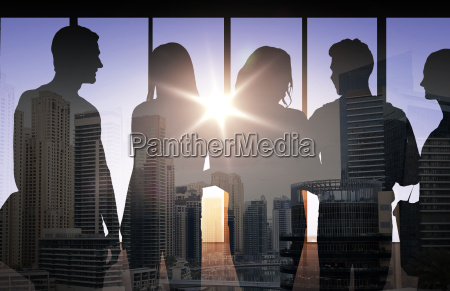 people silhouettes over city background