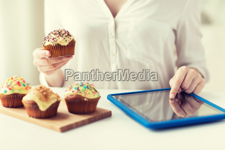 close up of woman with cupcakes