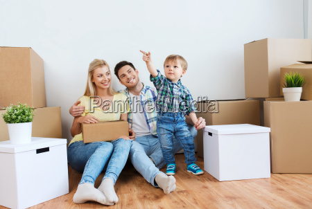happy family with boxes moving to