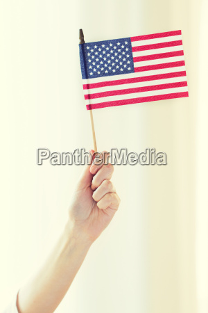 close up of woman holding american