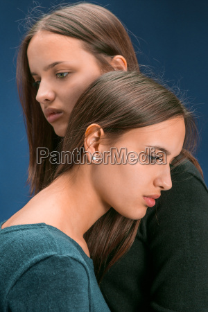 portrait of two beautiful twin young