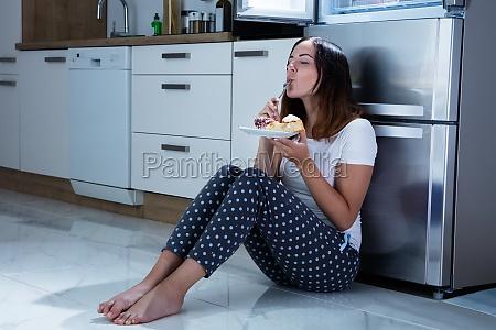 woman enjoy eating sweet food in