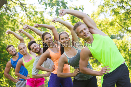 group of friends or sportsmen exercising