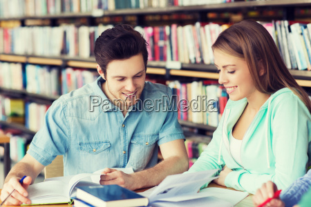 students with books preparing to exam