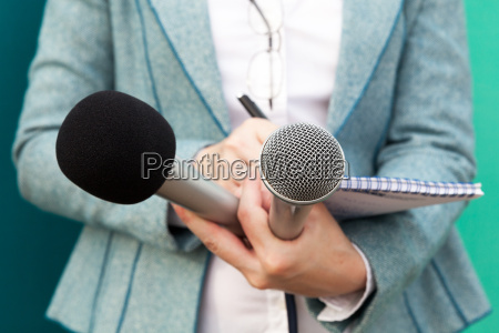 female reporter at press conference writing