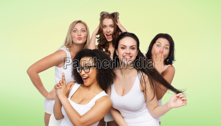 group of happy women in white