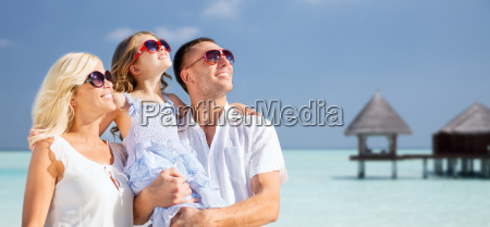 happy family over tropical beach with