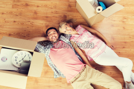 couple with big cardboard boxes moving