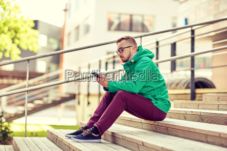 young hipster man with smartphone in
