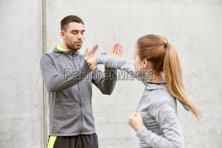 woman with trainer working out self