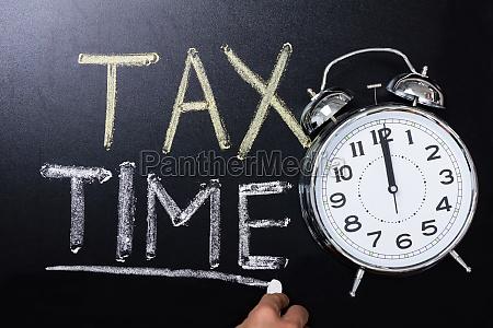 alarm clock near tax time concept