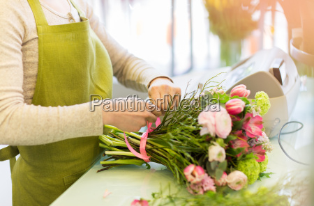 close up of woman making bunch