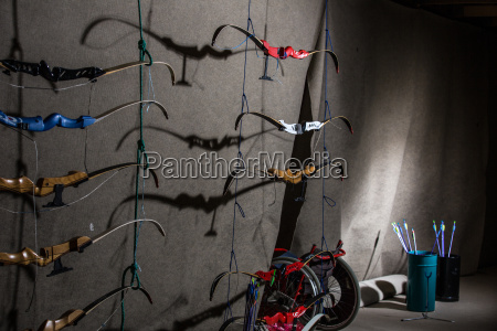 bows and arrows in an indoor