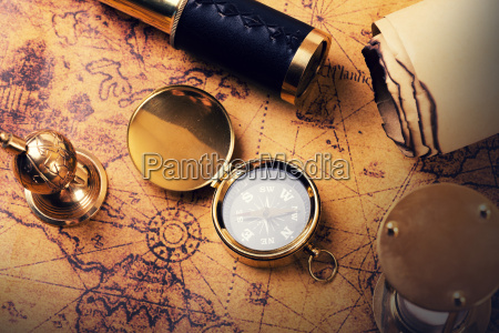 vintage compass and equipment on ancient