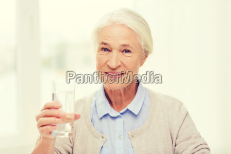 happy senior woman with glass of