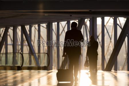 businessman at airport corridor walking to