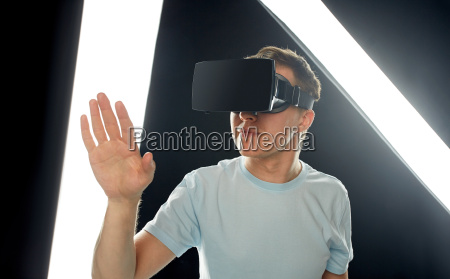 happy man in virtual reality headset
