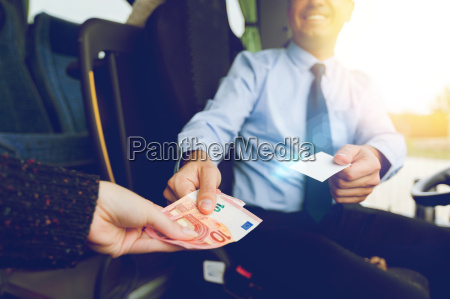 close up of bus driver selling