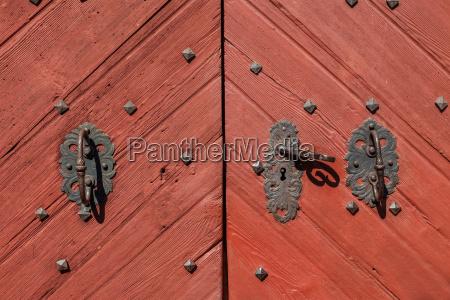 old wooden door at village church