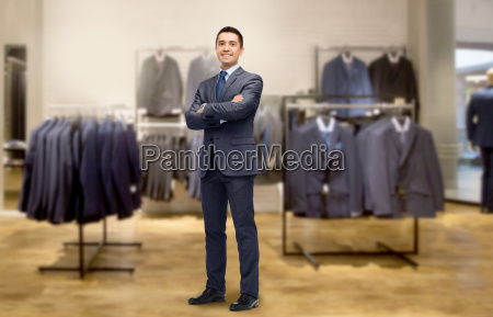 happy businessman in suit over clothing