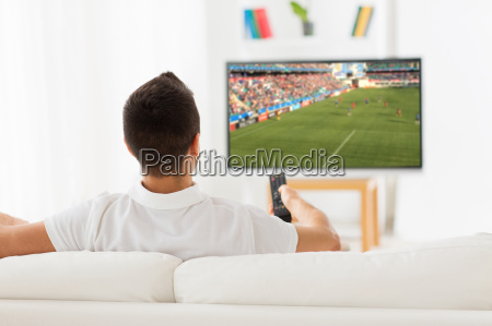 man watching football or soccer game