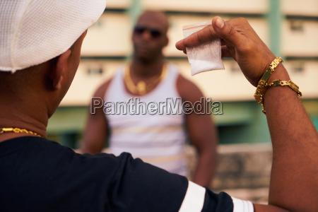 gang members meeting for selling and