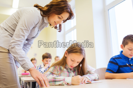 group of school kids writing test