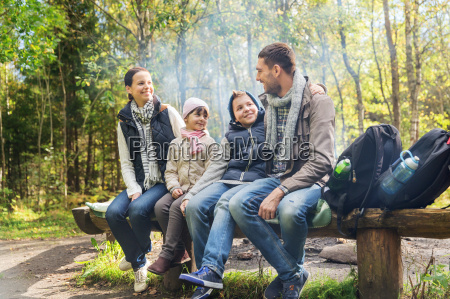 happy family sitting on bench and