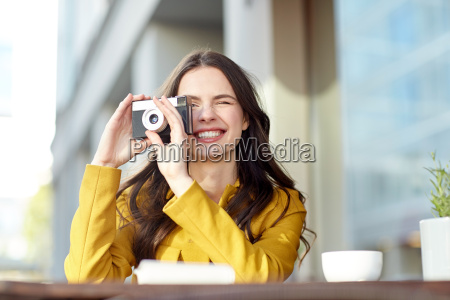 happy tourist woman with camera at