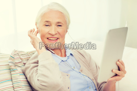senior woman with tablet pc and