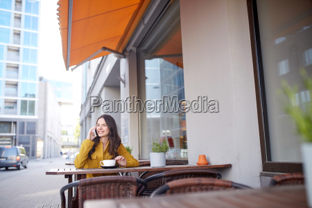 happy woman calling on smartphone at