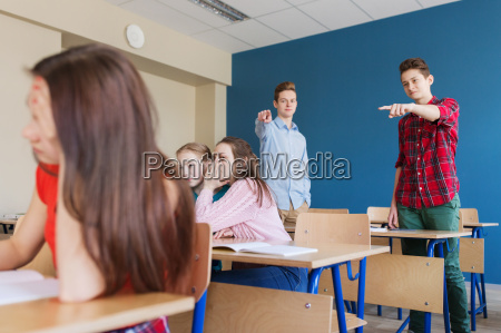 students gossiping behind classmate back at