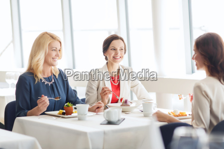 women eating dessert and talking at