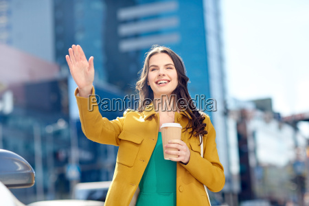 happy young woman drinking coffee on
