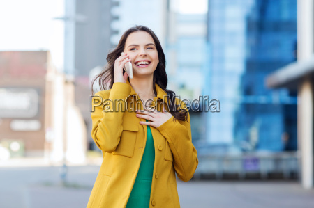 smiling young woman or girl calling