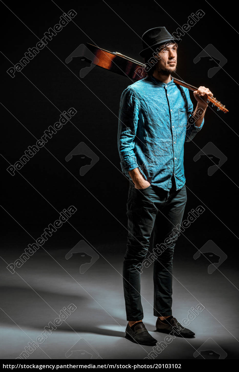 cool, guy, standing, with, guitar, on - 20103102