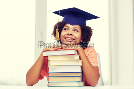 happy african bachelor girl with books