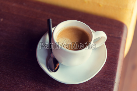 cup of black coffee with spoon