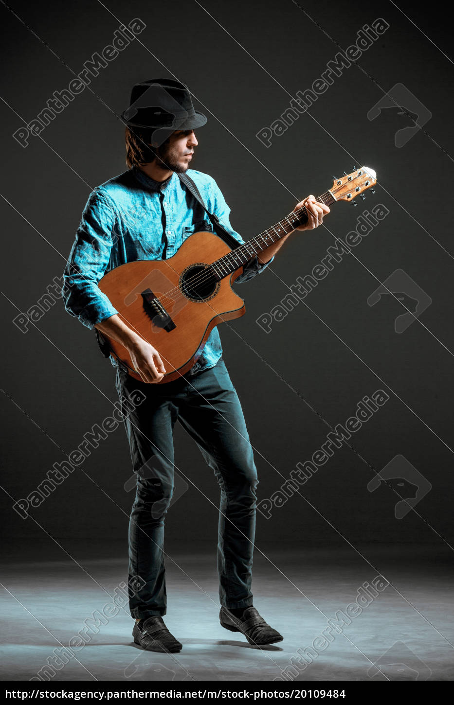 cool, guy, standing, with, guitar, on - 20109484