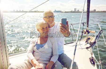seniors with smartphone taking selfie on