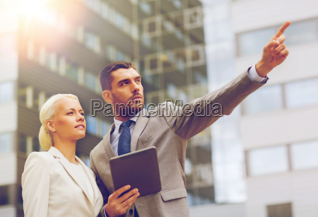serious businessmen with tablet pc outdoors