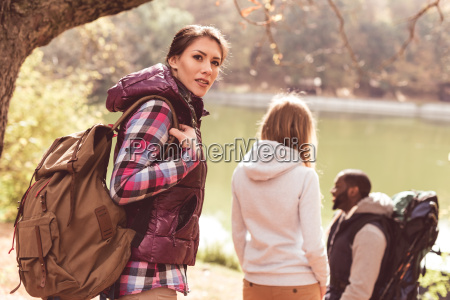 young, backpackers, walking, near, river - 20114912