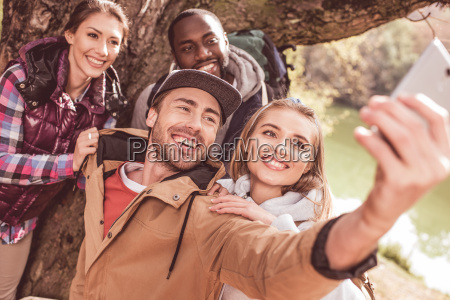 young, people, taking, selfie, in, forest - 20114924