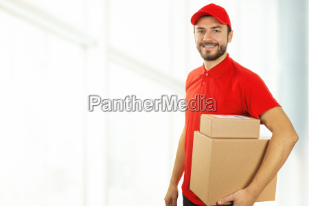 delivery man with cardboard boxes standing