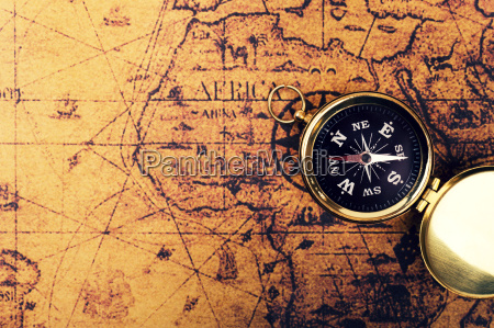 compass on old vintage world map