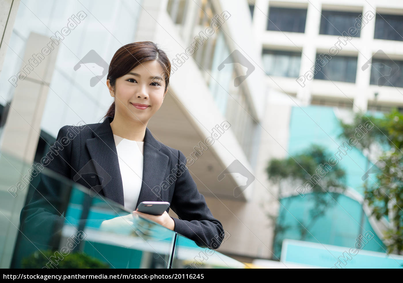 asian, business, woman, holding, a, cellphone - 20116245